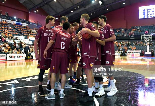 The Bullets embrace before the round 10 NBL match between the Cairns Taipans and the Brisbane Bullets at Cairns Convention Centre on December 14 2017...
