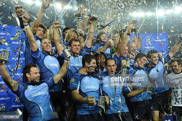 THe Bulls rugby team celebrates after winning the final on May 29 2010 at the end of the Super14 Final match between Bulls and Stormers at Soweto's...