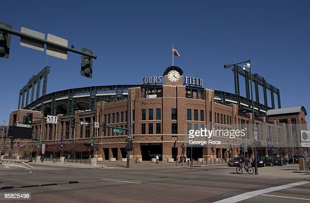 The Bulova clock and American Flag adorn the entrance to Coors Field as seen in this 2009 Denver, Colorado, spring cityscape photo.