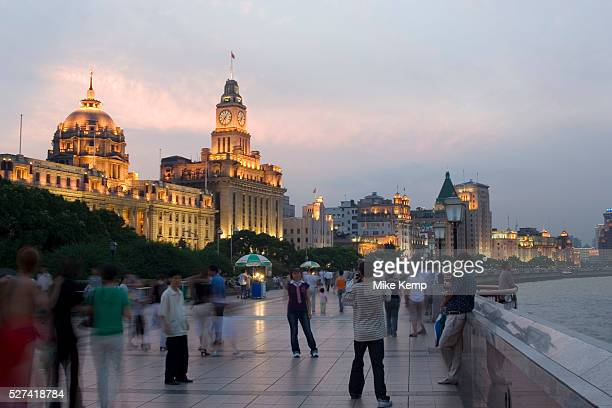 The Bund at sunset Every day at sundown tourists gather to watch the sun go down and the lights all along the Huang Pu River come to life The Bund's...