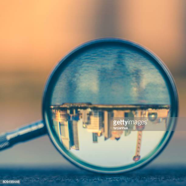 the bund of Shanghai reflected in a magnifying glass at dusk