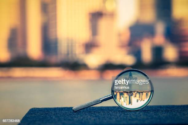 the bund of shanghai reflected in a magnifying glass - image focus technique stock pictures, royalty-free photos & images
