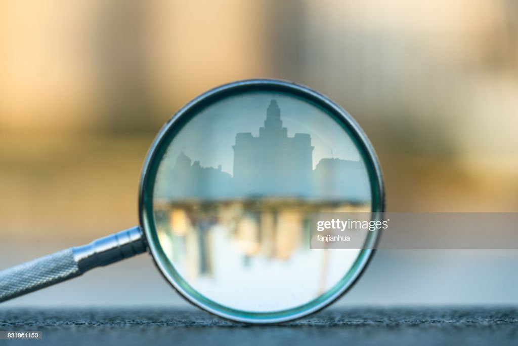 the bund of Shanghai reflected in a magnifying glass : Stock Photo