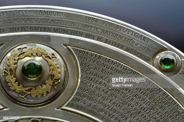 The Bundesliga trophy on display prior to the Bundesliga match between Bayern Muenchen and VfB Stuttgart at Allianz Arena on May 10, 2014 in Munich,...