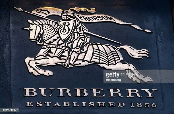 The Burberry Group Plc logo sits on a sign outside of the company's new flagship luxury clothing store in London UK on Monday Sept 17 2012 Burberry...