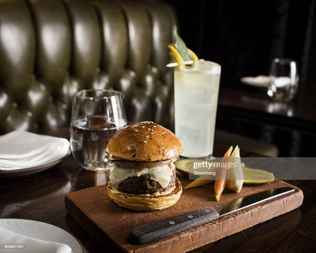 The Burger is arranged for a photograph at the NoMad Bar in New York, U.S., on Monday, April 18, 2016. Top chefs pick their all-time favorites, from burgers with fat, mid-rare patties dripping with juice to thin, crisp disks of beef smothered with cheese. These are the ones the true masters crave when they're off duty. Photographer: Eric Medsker/Bloomberg via Getty Images