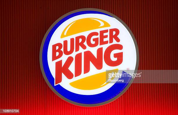 The Burger King company logo is displayed outside a restaurant in Basildon UK on Wednesday Sept 8 2010 Burger King Holdings Inc agreed to be acquired...