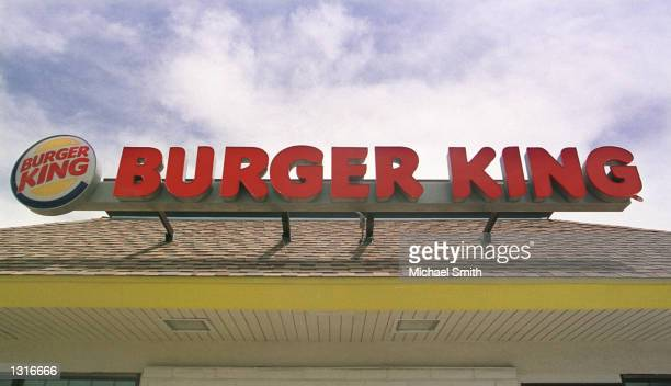 The Burger King logo and sign sit atop a Burger King restaurant June 12 2001 in Federal Heights Colorado The fastfood chain Burger King Corp has...