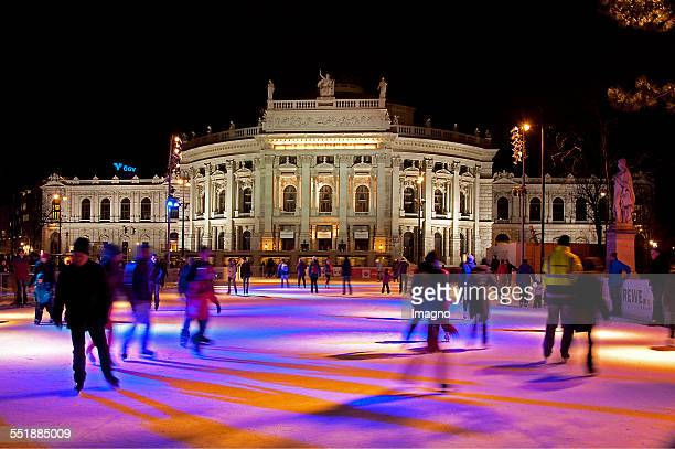 The Burgtheater with a view to the ice rink on City Hall Square Vienna 2013 Photograph by Gerhard Trumler
