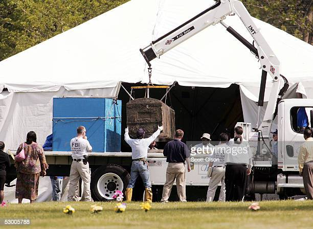 The burial vault containing the remains of Emmett Till is lowered onto a flatbed truck at Burr Oak Cemetery June 1 2005 in Alsip Illinois The FBI is...