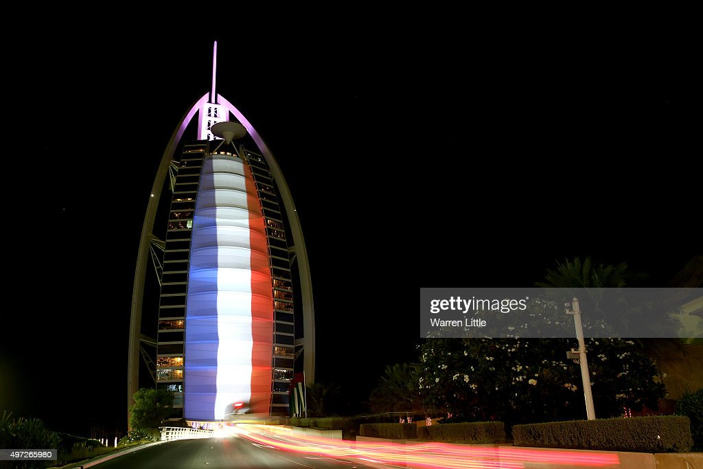The Burj Al Arab Hotel is illuminated in the colours of the French flag on November 15, 2015 in Dubai, United Arab Emirates. At least 120 people have been killed and over 200 are injured in Paris following a series of terrorist acts in the French capital on Friday.