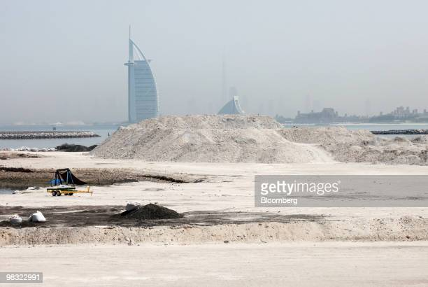 The Burj al Arab hotel is seen in the distance from an undeveloped part of Dubai World's Palm Jumeirah island in Dubai United Arab Emirates on...