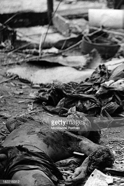 The burned body of a Viet Cong pulled out of a crater after the explosion of a mine Vietnam 1968