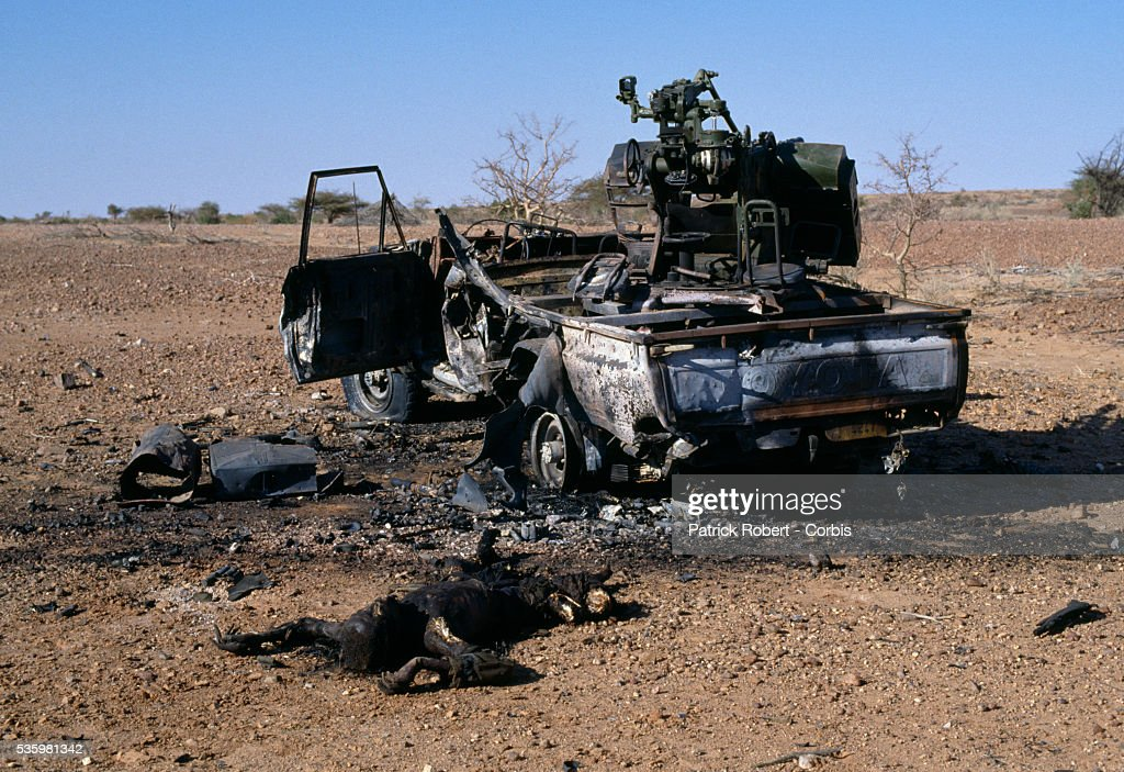 The burned corpse of a rebel soldier with the Forces Armées Nationales Chadiennes (FANT) lies in the sand near a burned military tank after the battle between Idriss Deby's partisans and Hissen Habre's troops. Lead by Deby, the Chadian Chief of Staff, the FANT rebellion seized power from head of state Hissen Habre in a French- and Libyan-backed military coup. Deby later won the first multi-party Chadian presidential vote in 1996.