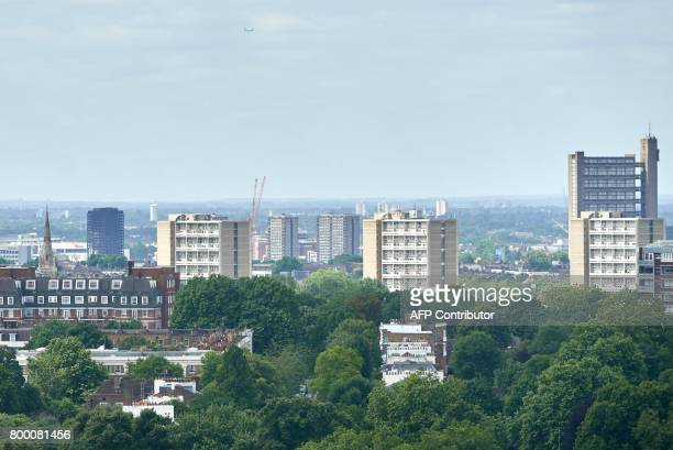 The burned out Grenfell Tower in North Kensington is pictured from a tower block on the Chalcots Estate in north London on June 23 2017 Tower blocks...