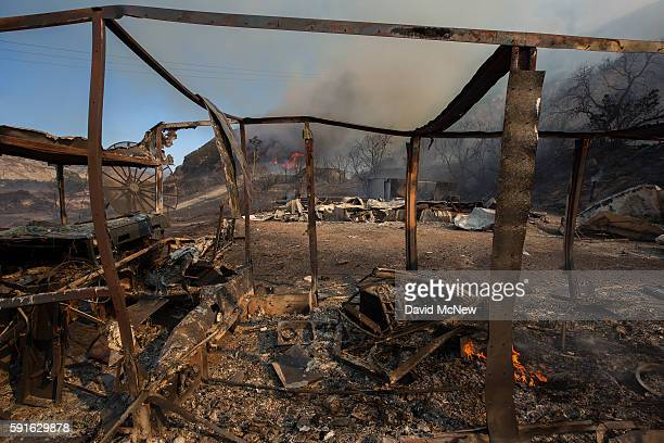 The burned remains of structures are seen at the Blue Cut Fire on August 17 2016 near Wrightwood California An unknown number of homes and businesses...