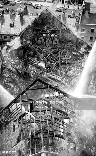 The burned remains of the Old Howard Theatre in Boston are pictured on June 20 1961 A threealarm blaze destroyed the shuttered theater and city...