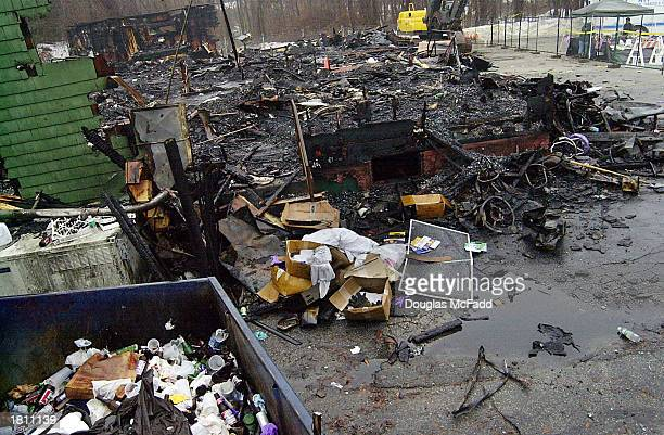 The burned remnants of 'The Station' nightclub litters the scene February 23 2003 in West Warwick Rhode Island A deadly fire that took the lives of...