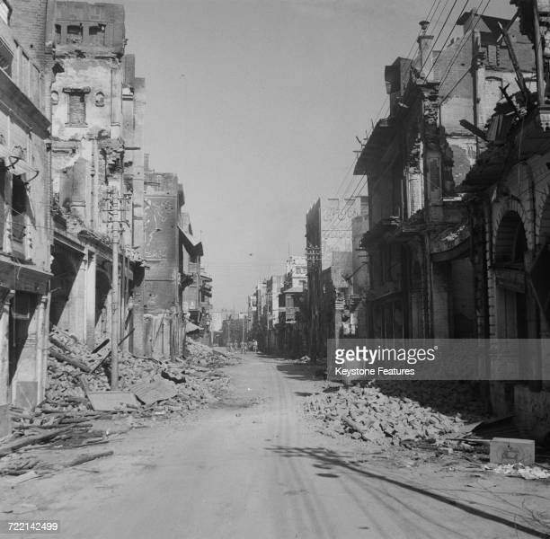 The burnedout Hall Bazaar shopping street after communal riots in Amritsar Punjab during the Partition of British India March 1947 Fighting took...
