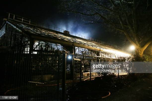 The burnedout monkey house of the zoo in Krefeld western Germany is pictured on early January 1 2020 Fire ripped through the monkey house at Krefeld...