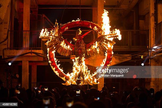 The burnig symbol of the movie is pictured during the 'The Hunger Games Mockingjay Part 1' preview event at Kraftwerk Mitte on November 11 2014 in...