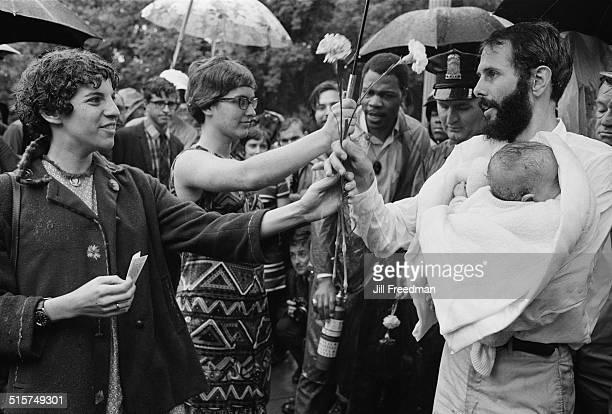 The burning of draft cards in Washington DC during an antiVietnam War demonstration 1968