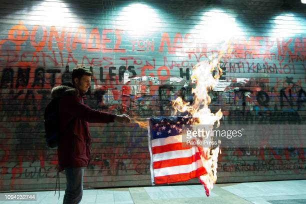 The burning of the American flag from member of Communist Youth of Greece in front of the American consulate. Protesters from the Communist Youth of...