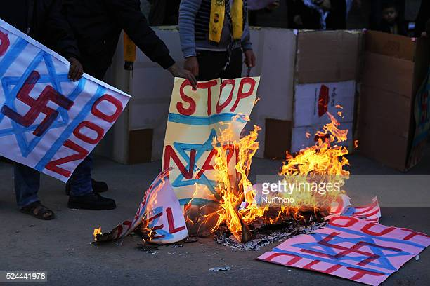 The burning of the Israeli flag and notices of Palestinians in protest to demand the release of prisoners in Israeli jails in front of the Red Cross...