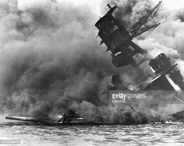The burning USS Arizona lists and sinks after the Japanese attack on Pearl Harbor Hawaii on December 7 1941 The ship was a total loss and many of her...