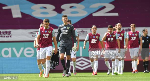 The Burnley players enter the pitch for the game during the Premier League match between Burnley FC and Brighton Hove Albion at Turf Moor on July 26...