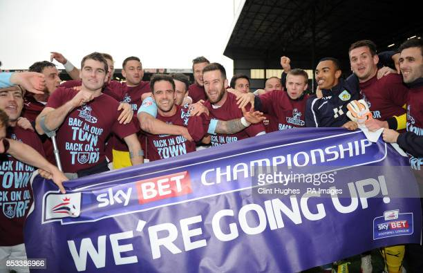 The Burnley team celebrates after they win promotion to the Premier League during the Sky Bet Championship match at Turf Moor Burnley