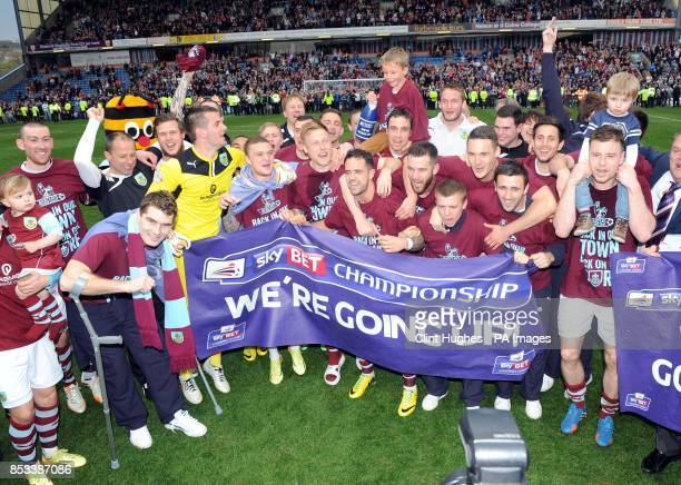 The Burnley team celebrates after winning promotion to the Premier League during the Sky Bet Championship match at Turf Moor Burnley