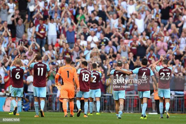 The Burnley team show appreciation to the fans after the Premier League match between Tottenham Hotspur and Burnley at Wembley Stadium on August 27...