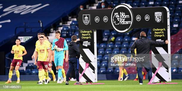 The Burnley Team walks out in front of the No Room for Racism banner ahead of the Premier League match between West Bromwich Albion and Burnley at...