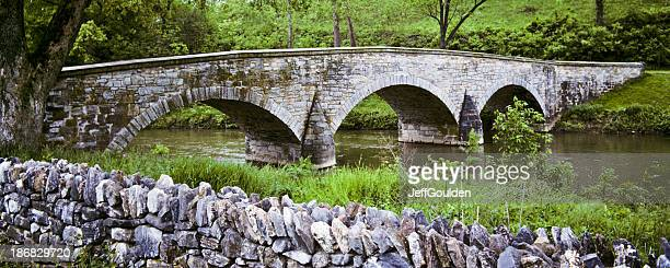 historic burnside bridge and stone wall - antietam national battlefield stock photos and pictures