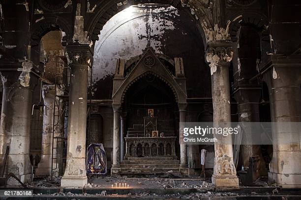 The burnt and destroyed interior of the St Mary al-Tahira church is seen on November 8, 2016 in Qaraqosh, Iraq. The NPU is a military organization...