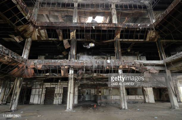 The burnt Central Library in the Faysaliyah quarter in Iraq's northern city of Mosul is pictured on April 17, 2019. - For centuries, Mosul was known...