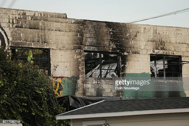 The burnt exterior of a warehouse in which a fire claimed the lives of at least thirtythree people is seen on December 4 2016 in Oakland California...