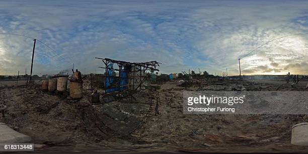 The burnt Jungle camp smoulders on October 26 2016 in Calais France Overnight and throughout the day fires broke out in many parts of the camp...