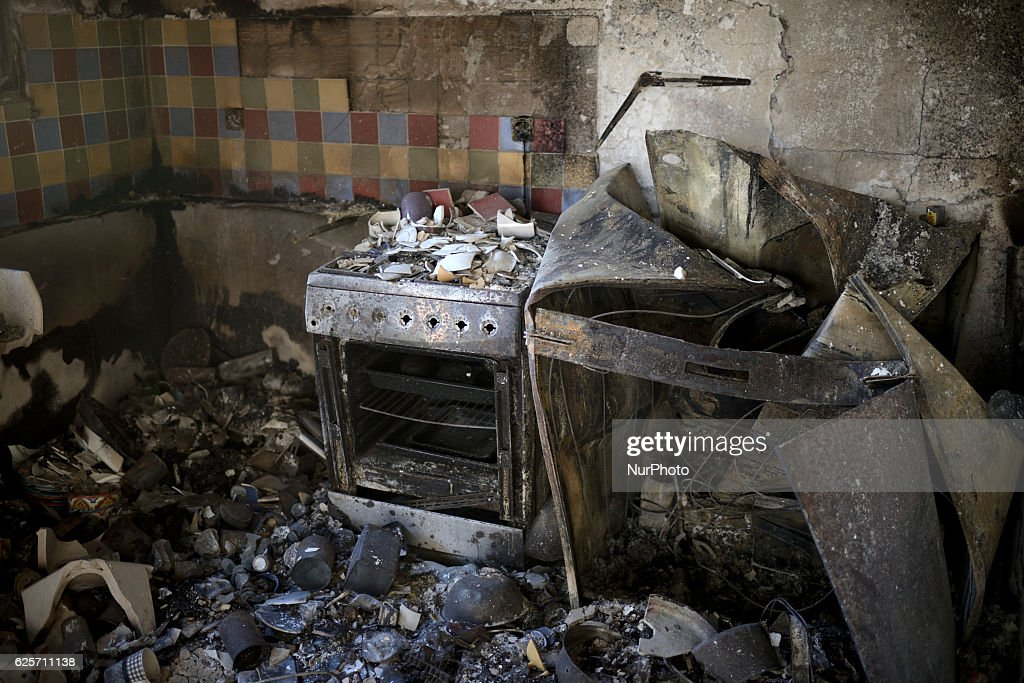 The burnt kitchen of a house hit by a masive forest fire in the Northern city of Haifa, Israel on November 25, 2016. The massive fire in the city of Haifa lead to the evacuation of dozens of thousands of city residents and is part of a lrage wave of forest fires errupted all over Israel during the last days.