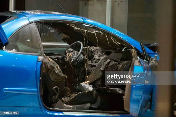The burnt out interior of a car is seen in the lobby of the German Social Democratic Party headquarters after a vehicle was used to ram the building...