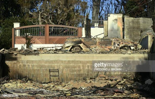 The burnt out remains of a vehicle is seen at a home in the beachside community of Point Dume in Malibu California on November 11 as the battle to...
