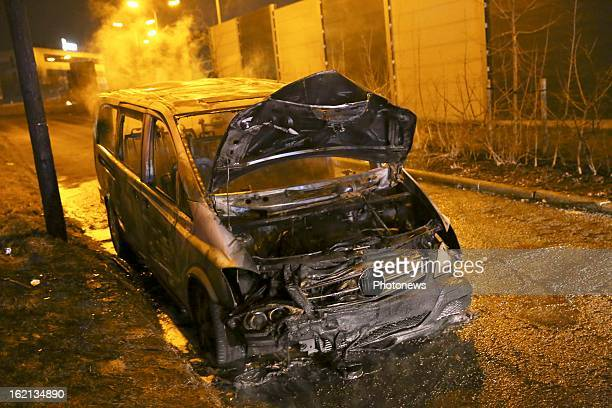The burnt out remains of the van used in the heist near Brussels Airport on February 18 2013 in Zaventem Belgium Using a van and car to break down...