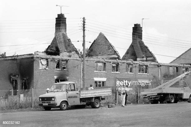 The burnt out shell of houses including the house of Dorothy Ryan 60 yearold mother of gunman Michael Ryan who went berserk with two semiautomatic...