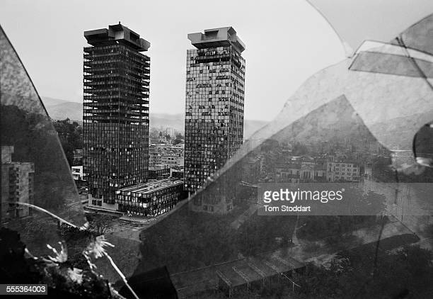 The burnt out tower blocks of Sarajevo's financial district seen through the shattered windows of the Holiday Inn Hotel