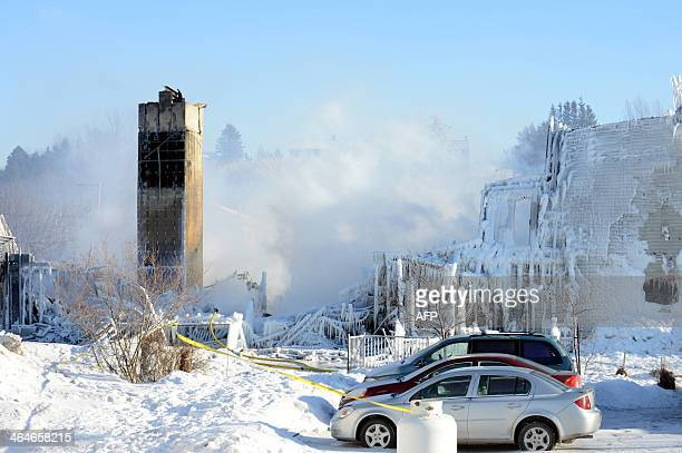 The burnt remains of a retirement home in L'IsleVerte are seen on January 23 2014 Firefighters searched the ashes of a Quebec retirement home that...