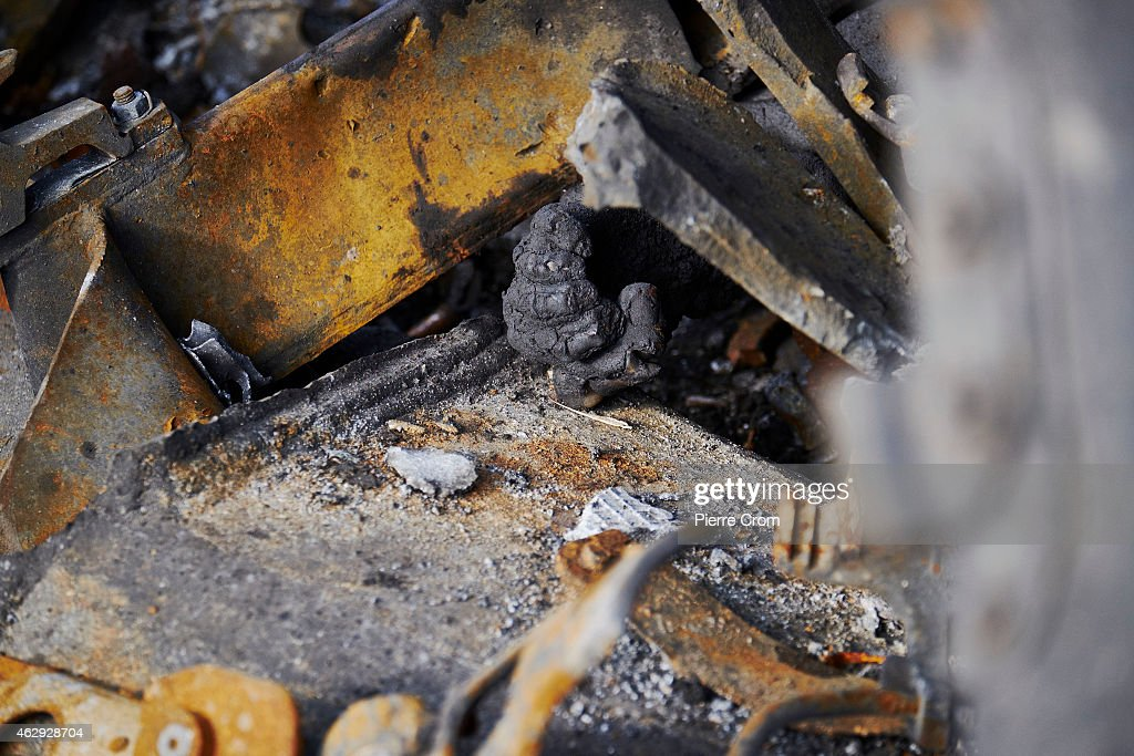 The burnt remains of a Ukrainian soldier protrude from a burnt-out Ukrainian tank on February 7, 2015 in Uglegorsk, Ukraine. According to Pro-Russian rebels, control of Uglegorsk, on the frontline near Debaltseve, was regained two days ago, after eight days of fierce fighting.