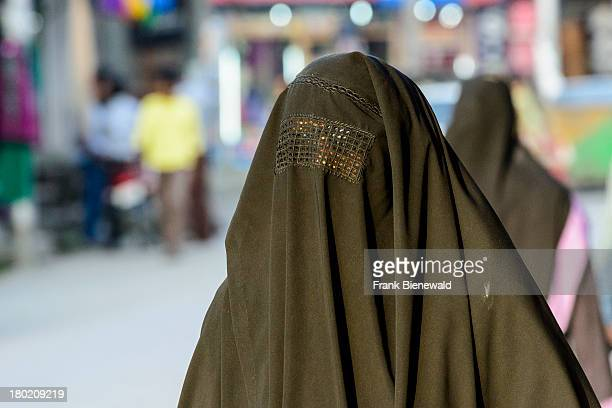 SRINAGAR JAMMU KASHMIR INDIA The Burqa covering the whole body and the face is a black outer garment worn by many Kashmiri women and female teenagers...