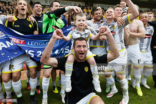 The Burton Albion team celebrate after winning the League after the Sky Bet League Two match between Cambridge United and Burton Albion at the Abbey...