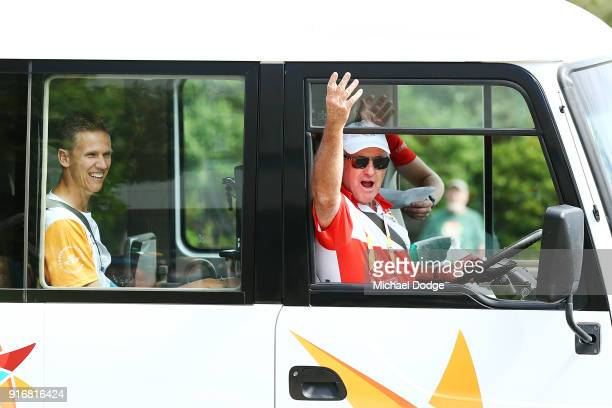 The bus driver tries to motivate the crowd while driving Queens Baton carrier Dan Langelaan to his position during the Queens Baton Commonwealth...